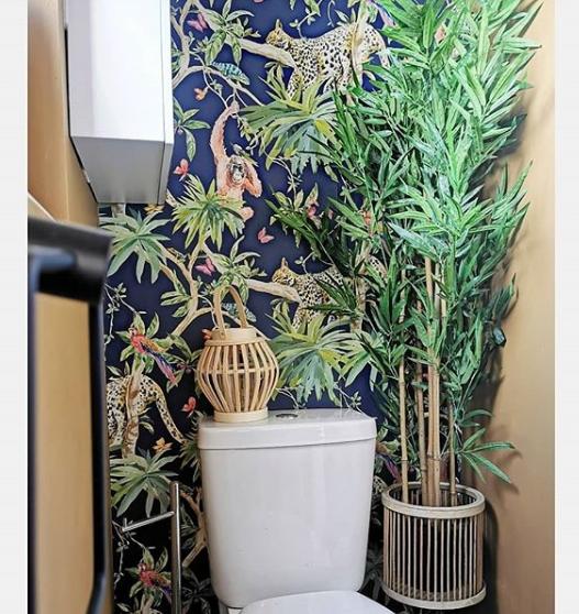 blue wallpaper lemur bathroom